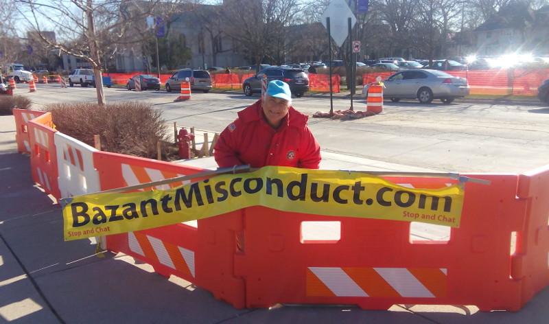 Dave Slesinger holds Bazant Banner